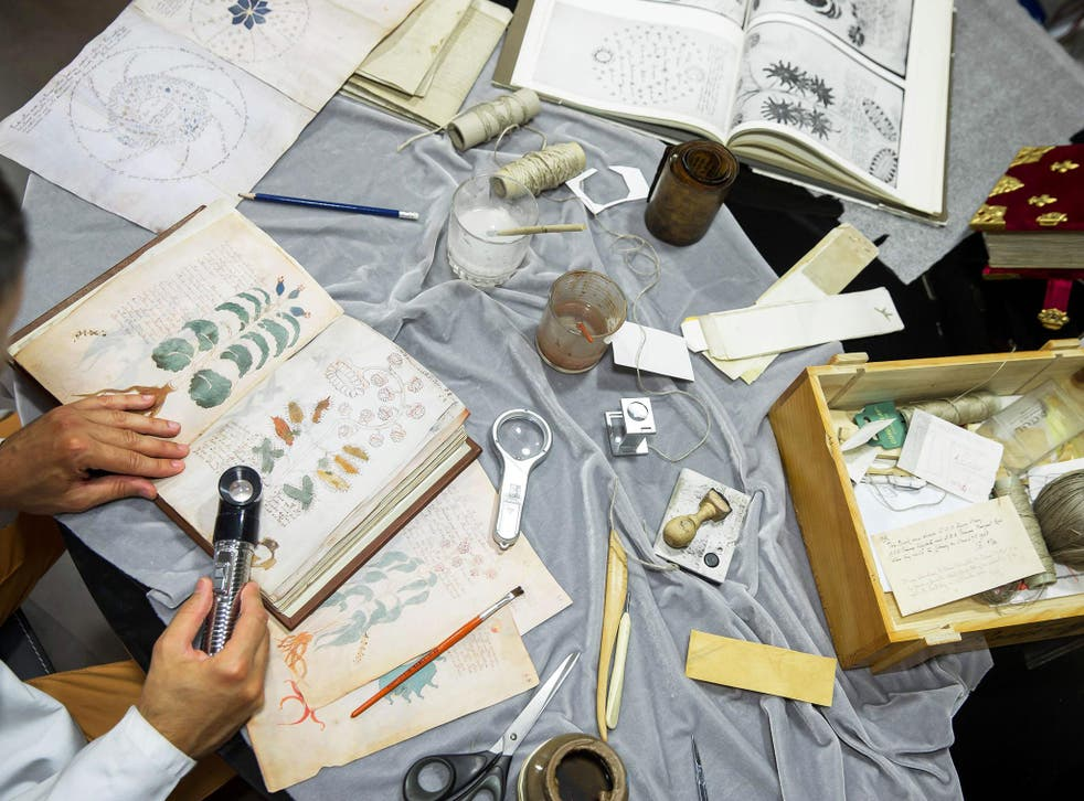 Quality control operator of the Spanish publishing outfit Siloe Luis Miguel works on cloning the illustrated codex hand-written manuscript Voynich in Burgos