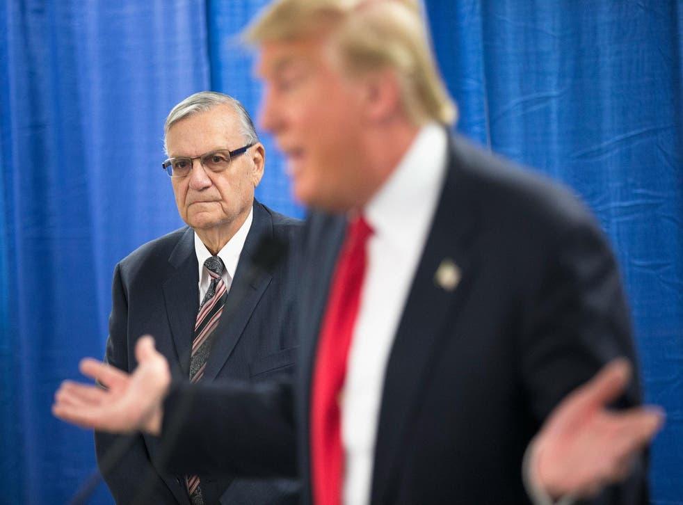 Joe Arpaio campaigning alongside Donald Trump in Iowa in January