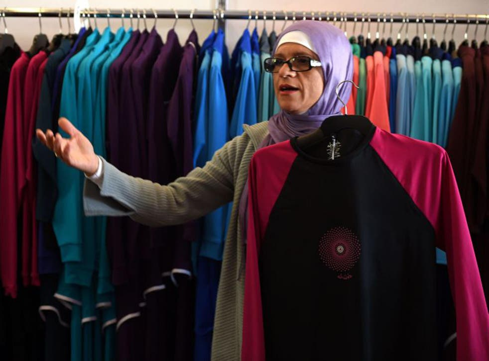 Australian-Lebanese designer Aheda Zanetti explains her products of burkini swimsuits at a shop in western Sydney