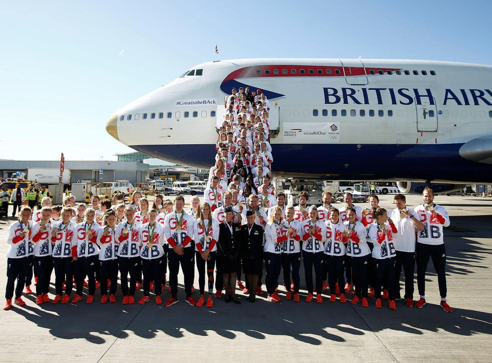 The medal-laden British team arrives at Heathrow from Rio