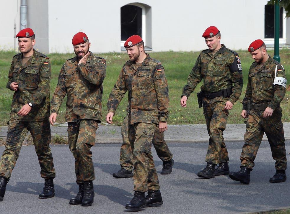 German soldiers walk through the Julius-Leber-Kaserne military barracks
