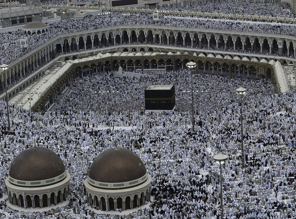 Pilgrims partake in the evening prayer inside the Grand Mosque and Holy Kabba in Mecca, the holiest Muslim site in the world