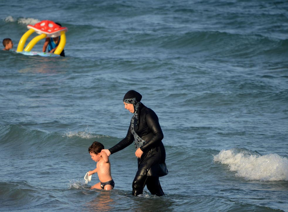 Women wearing Burqinis on certain French beaches can be fined