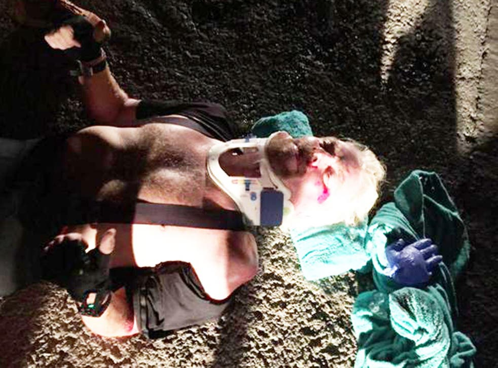 Sir Richard Branson receiving treatment after a cycling crash on the British Virgin Islands