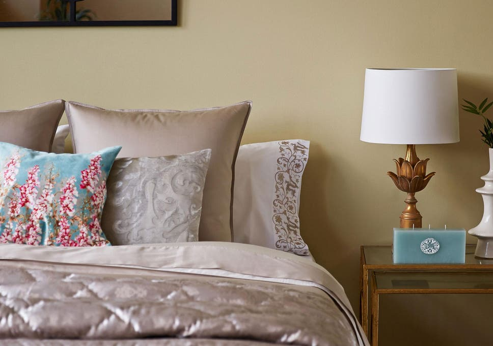 Add a little illumination to the bedroom with a stylish light