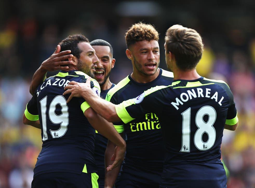 Arsenal's players celebrate following Santi Cazorla's goal