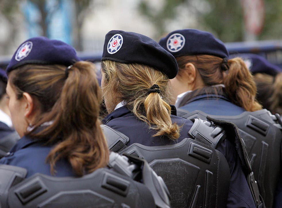 Turkish policewomen stand guard at the entrance of the the Holy Spirit Cathedral in Istanbul