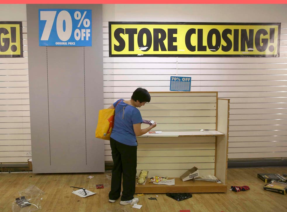 A woman shops in a branch of BHS before its final closure