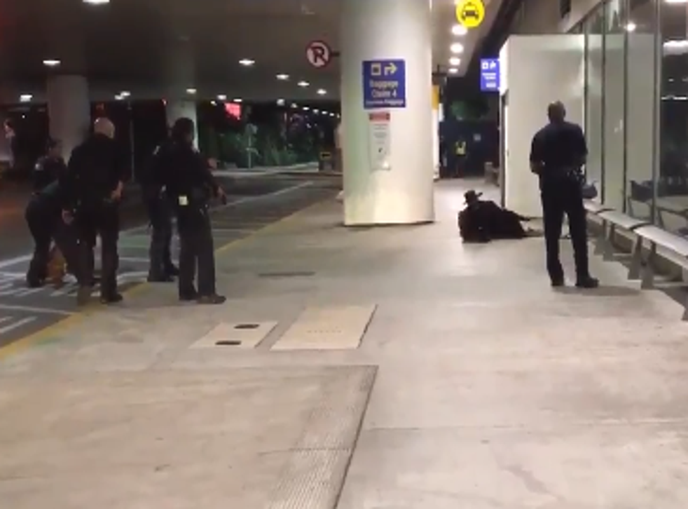 The footage shows a man dressed as Zorro being surrounded by six police officers and ordered to get on the ground