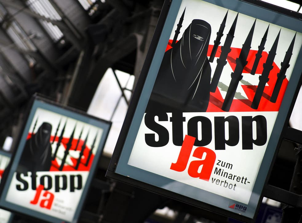 Posters for the right-wing Swiss People's Party, which supports a ban on both mosque minarets and face coverings