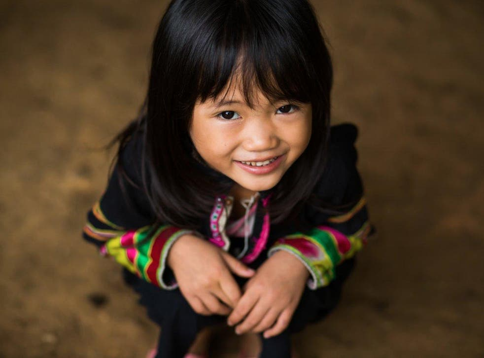 A little girl from the Black Lo Lo tribe