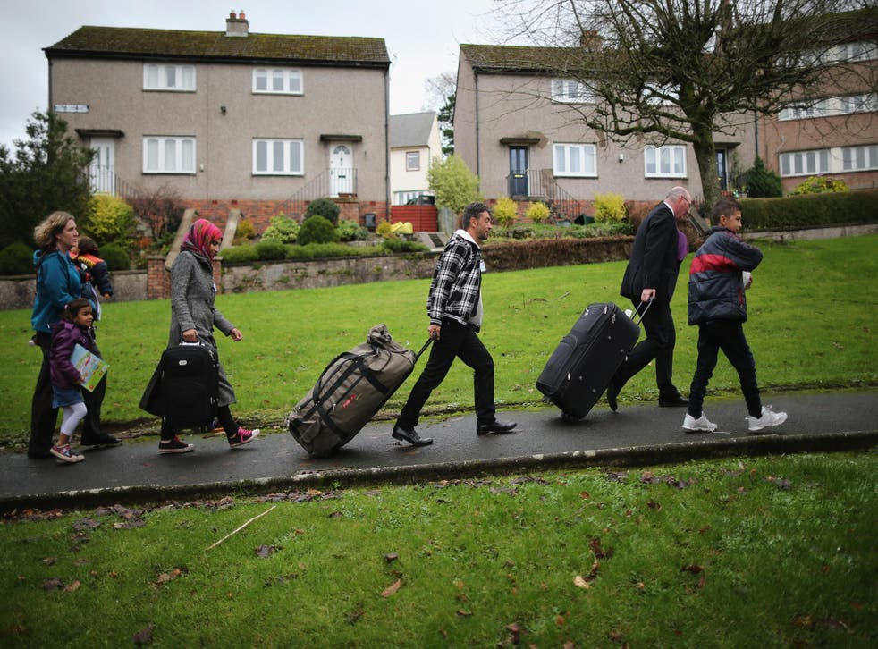 Syrian refugees arrive at their new home in Scotland in 2015