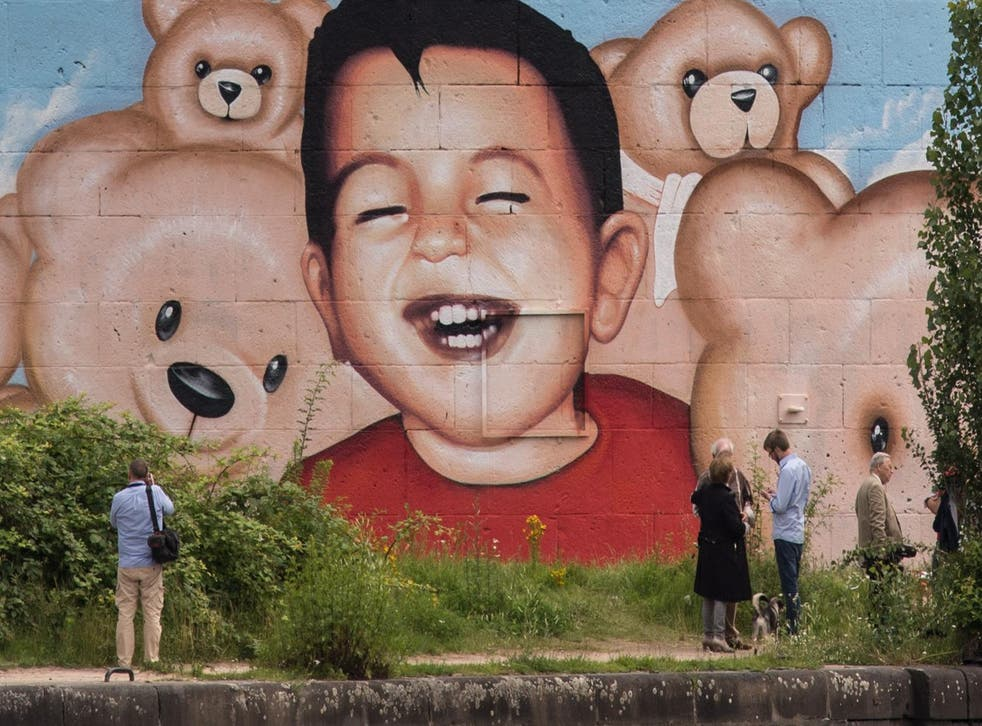 A mural depicting Syrian refugee Alan Kurdi in Frankfurt harbour