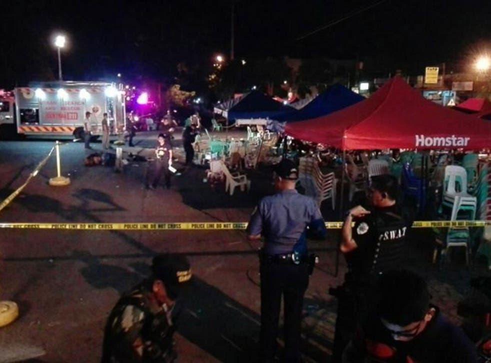 Policemen guard the scene of the blast