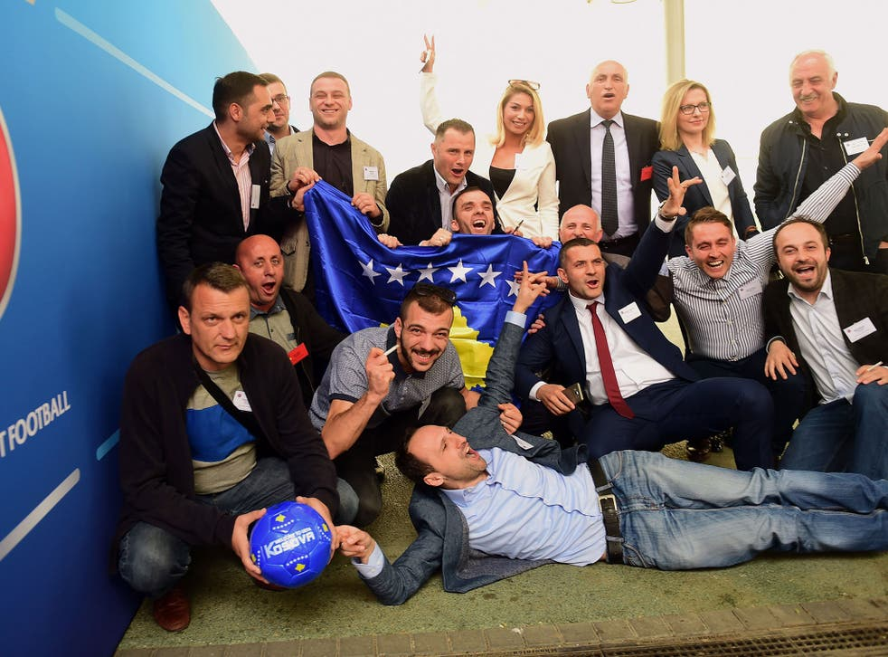 Delegation members of Kosovo celebrate gaining Uefa membership earlier this year