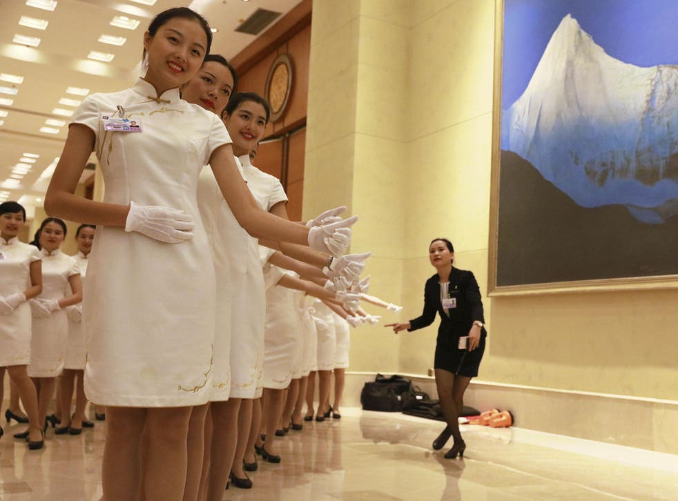 Chinese hostesses prepare for the arrival of world leaders and their staff at the G20 summit
