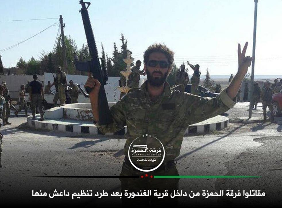 Free Syrian Army fighters at a roundabout in Al-Ganhurah, reportedly ending three years of Isis occupation