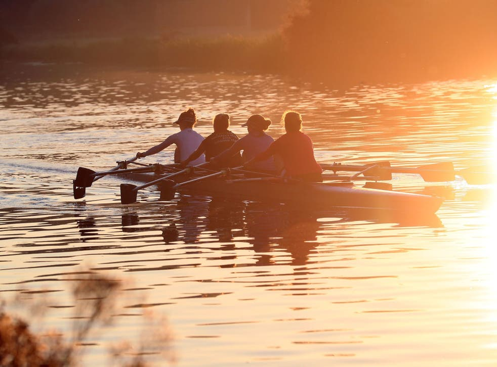 Rowers work out along the river Cam at sunrise in Cambridge, as the warm weather looks set to continue