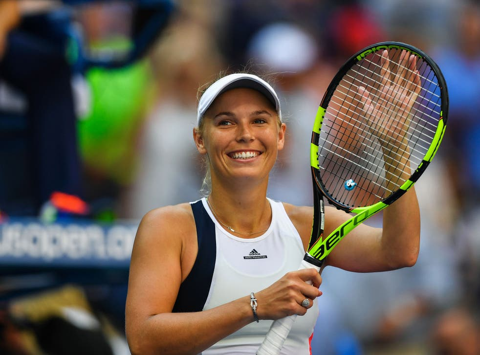 Caroline Wozniacki celebrates her fourth round victory over Madison Keys