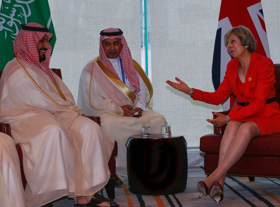 British PM Theresa May meets Saudi Arabia's delegates at the G20 summit in Hangzhou, China