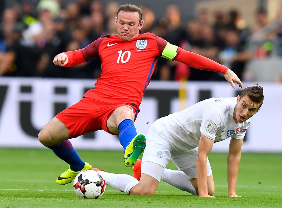 Instructions are issued to Wayne Rooney during the win over Slovakia