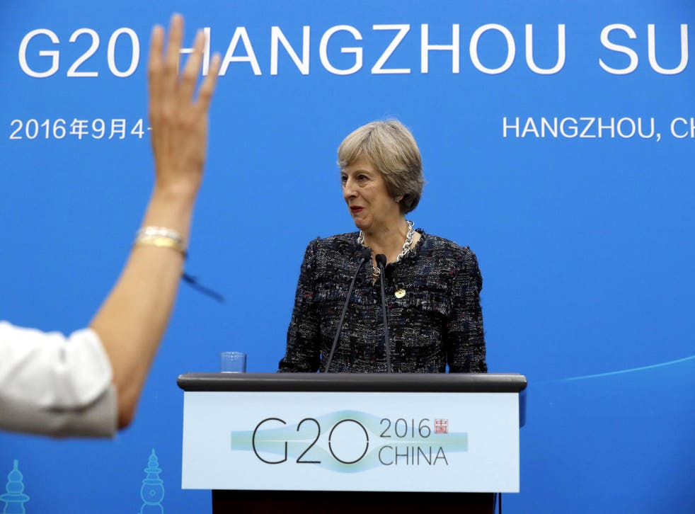 Theresa May prepares to take questions at a news conference held at the end of the G20 summit