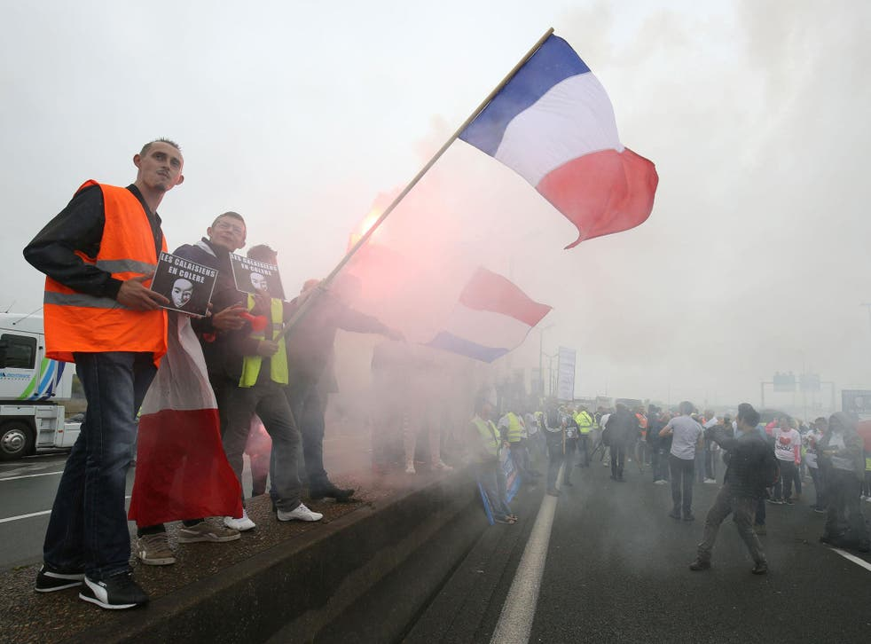 Protesters block the A16 highway around the port of Calais