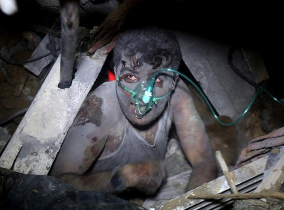 A Palestinian child is rescued from under the wreckage of their house, destroyed by an Israeli airstrike during Operation Protective Edge in July 2014