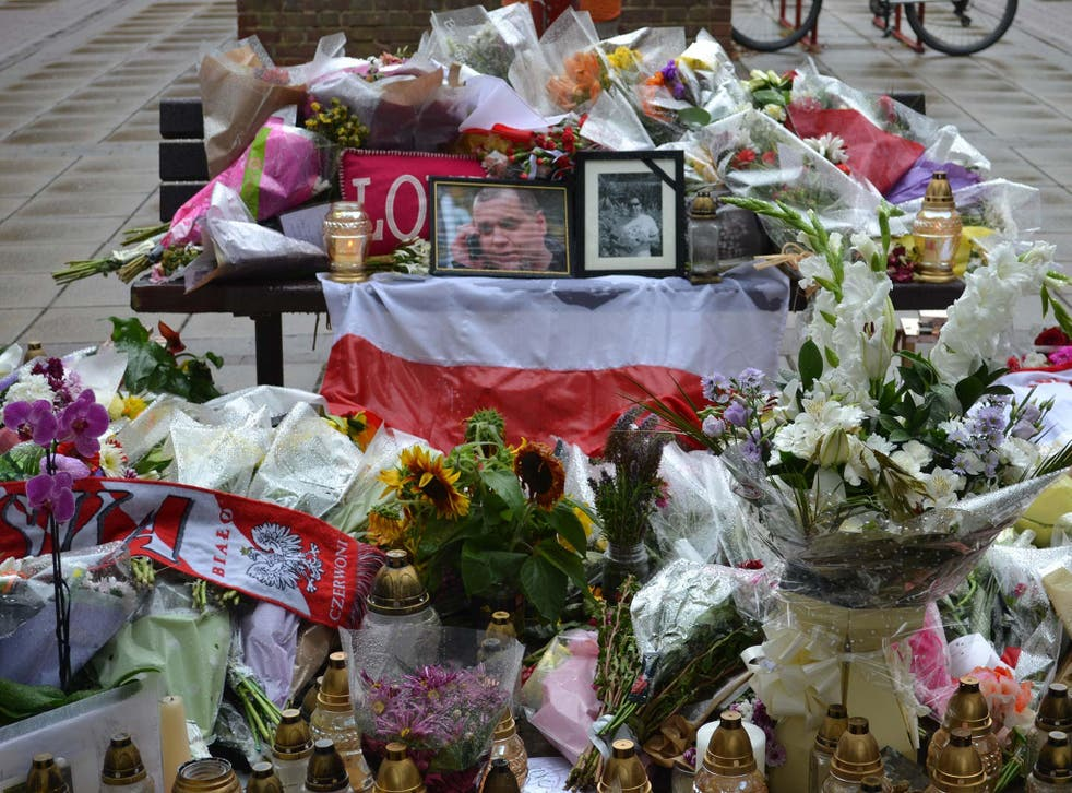 Tributes left in Harlow to a Polish man killed in a suspected hate crime