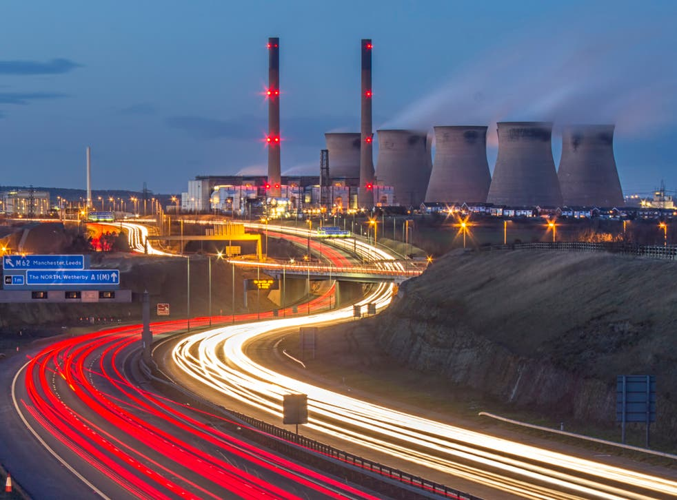 Power stations, like this one in Ferrybridge, Yorkshire, along with car engines, release nanoparticles including magnetite, which has now been found in human brains and could be linked to Alzheimer's