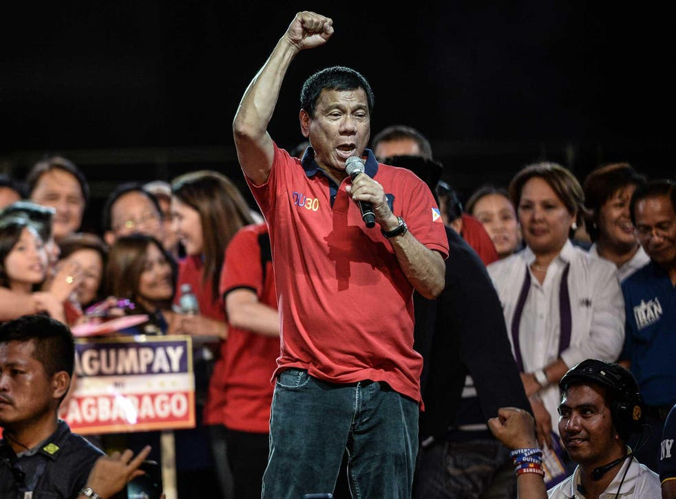 Mass-murder advocate Duterte at an election rally: he has promised medals to any member of the public who shoots a drug dealer