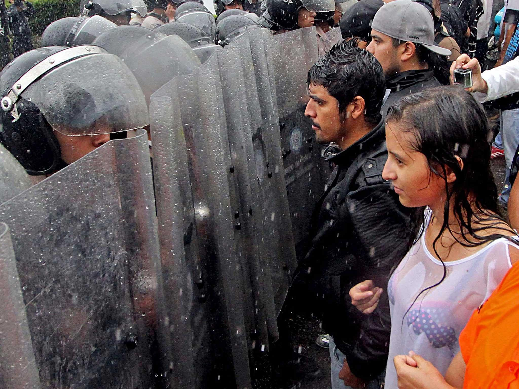Venezuelan opposition urges people to take to the streets over 'coup'