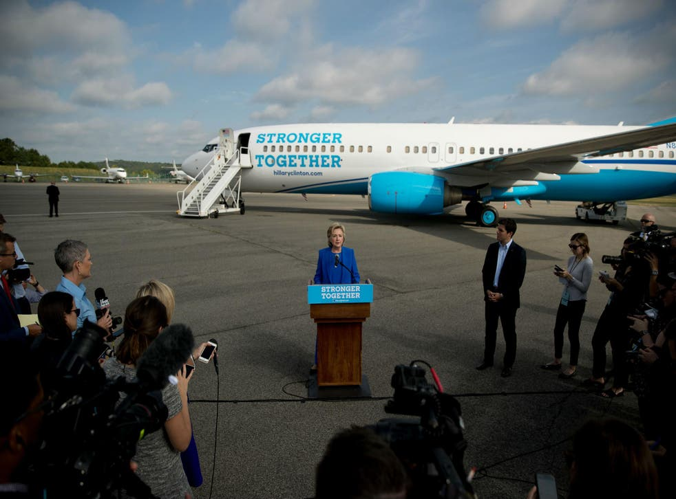 Hillary Clinton blasts Donald Trump with her campaign plane behind her