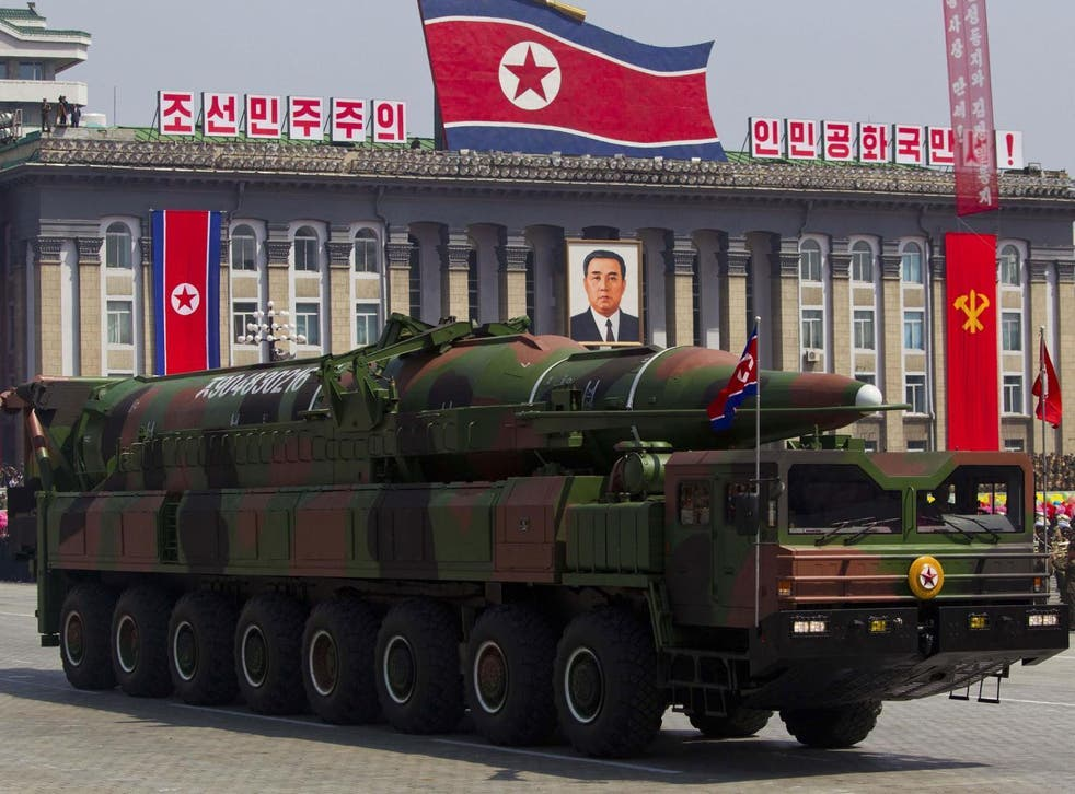 A North Korean vehicle carrying a missile passes by during a mass military parade in Pyongyang's Kim Il Sung Square to celebrate the centenary of the birth of the late North Korean founder Kim Il Sung