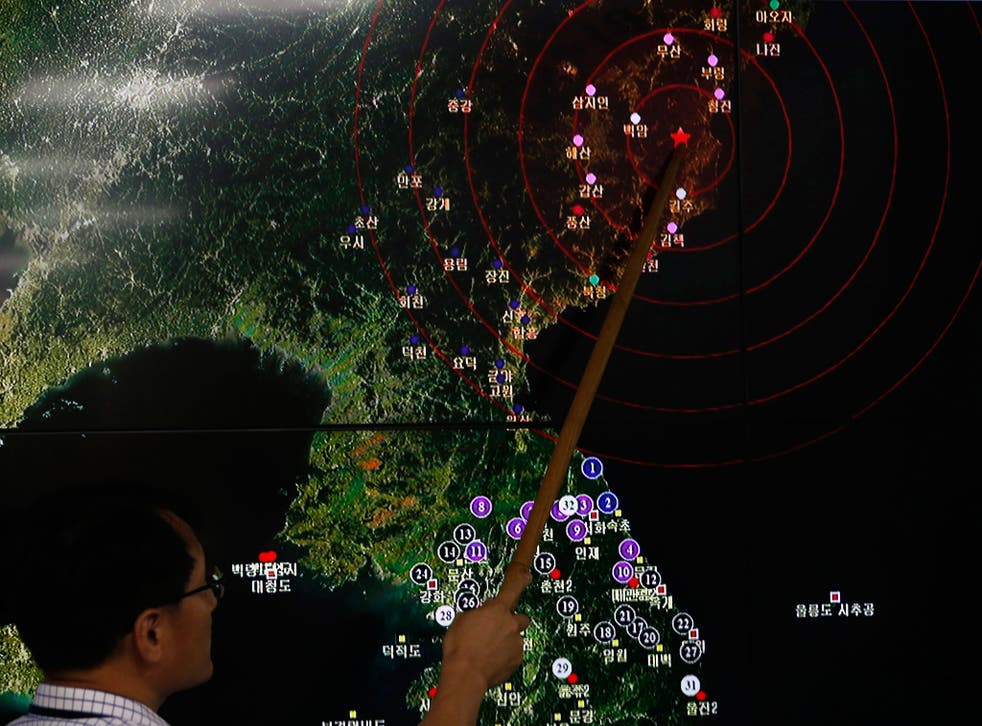 Ryoo Yong-Gyu, director of the earthquake monitoring division of South Korea's Meteorological Administration, shows seismic activity from a test in North Korea in Seoul on 9 September
