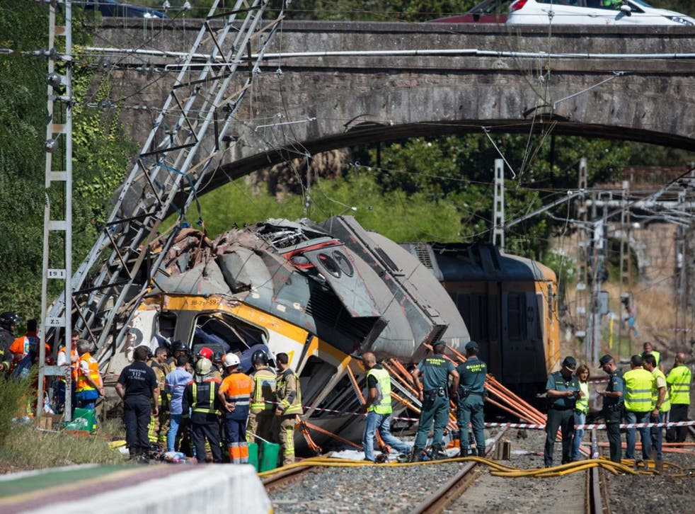 Emergency services at the scene after the train derailed and crashed into a tower