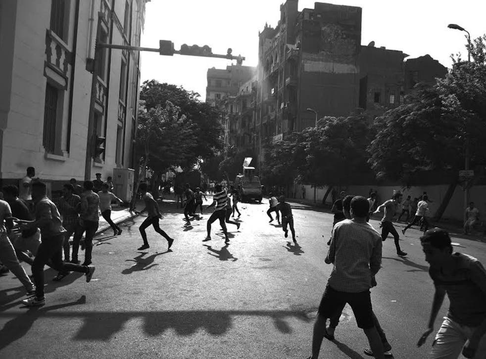 Protesters and security forces clash in Tahrir Square earlier this summer
