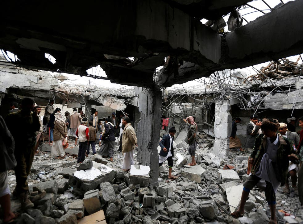 <p>People gather at a building destroyed by Saudi-led air strikes in the northwestern city of Amran, Yemen</p>