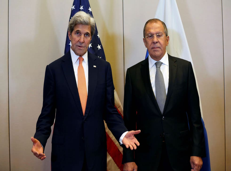 US Secretary of State John Kerry (L) gestures as he speaks while he arrives with Russian Minister for Foreign Affairs Sergei Lavrov (R) prior to a meeting to discuss the Syrian crisis on September 9, 2016, in Geneva