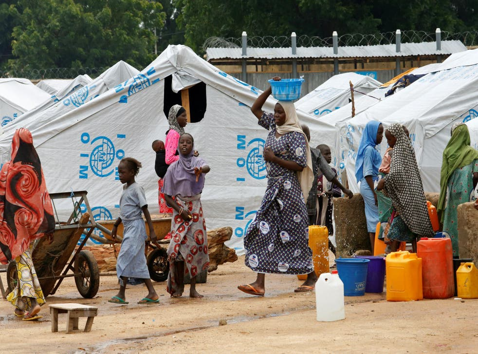 Women gather at a water station in a camp for internally displaced people in Bama, Borno state