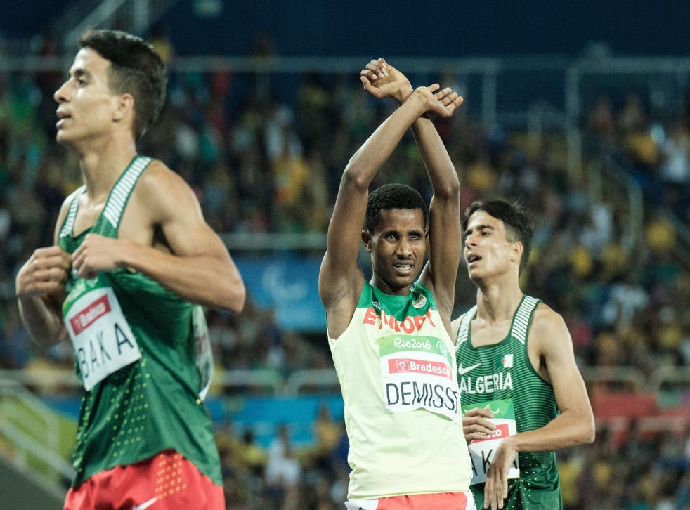 Ethiopia's Tamiru Demisse (C) reacts after the final of men's 1500 m (T13) of the Rio 2016 Paralympic Games at the Olympic stadium in Rio de Janeiro on September 11, 2016