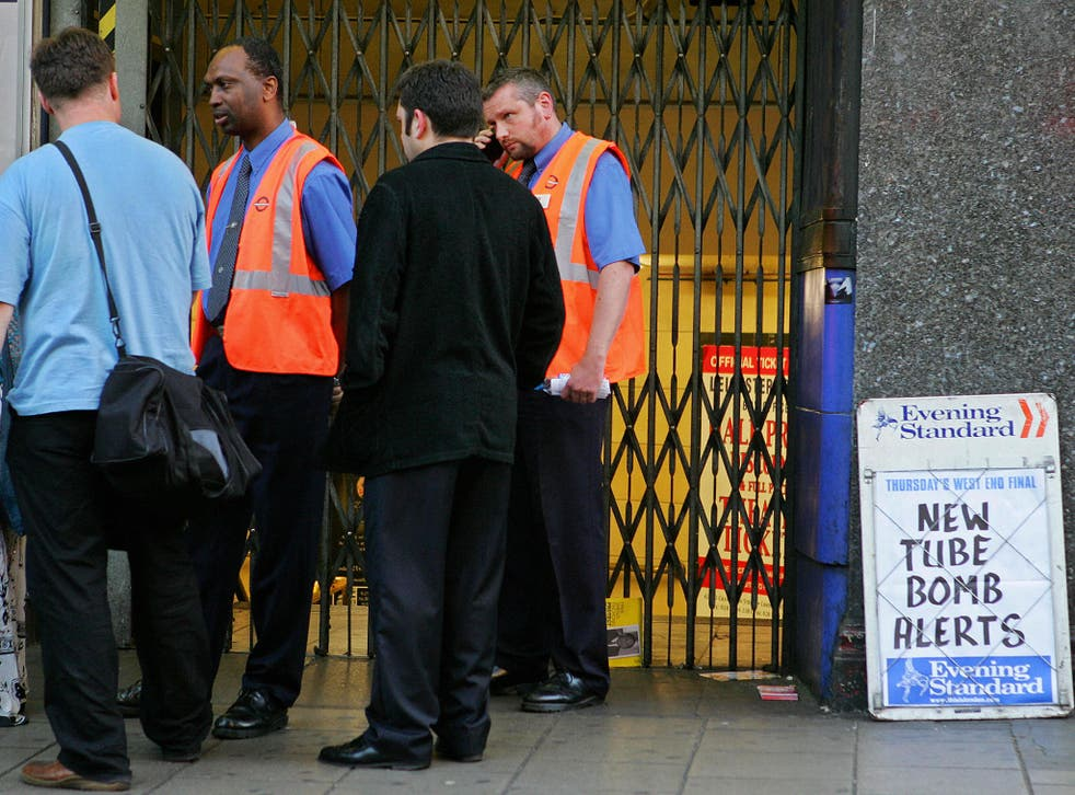 Underground staff at Leicester Square station direct commuters after the attempted bombings of 21 July, 2005