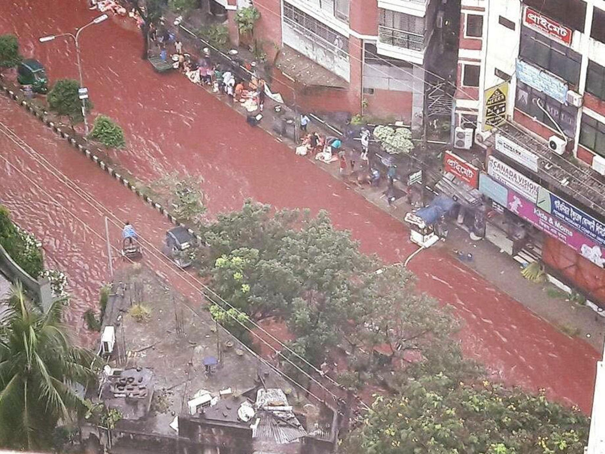 Blood runs through streets of Dhaka after mixing with monsoon rains during Eid al-Adha celebrations