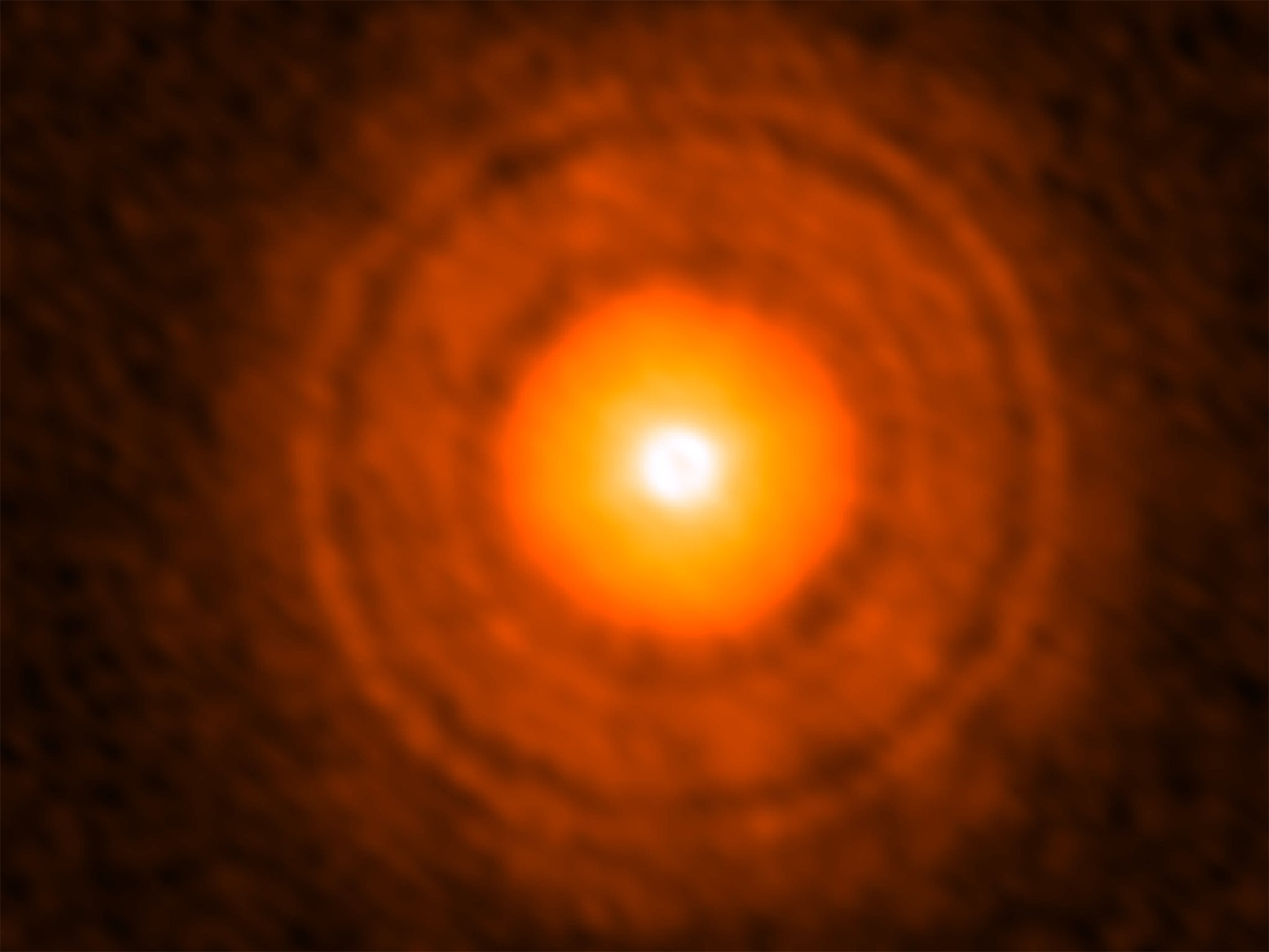 Astronomers discover signs of giant planet being born in star's dust cloud