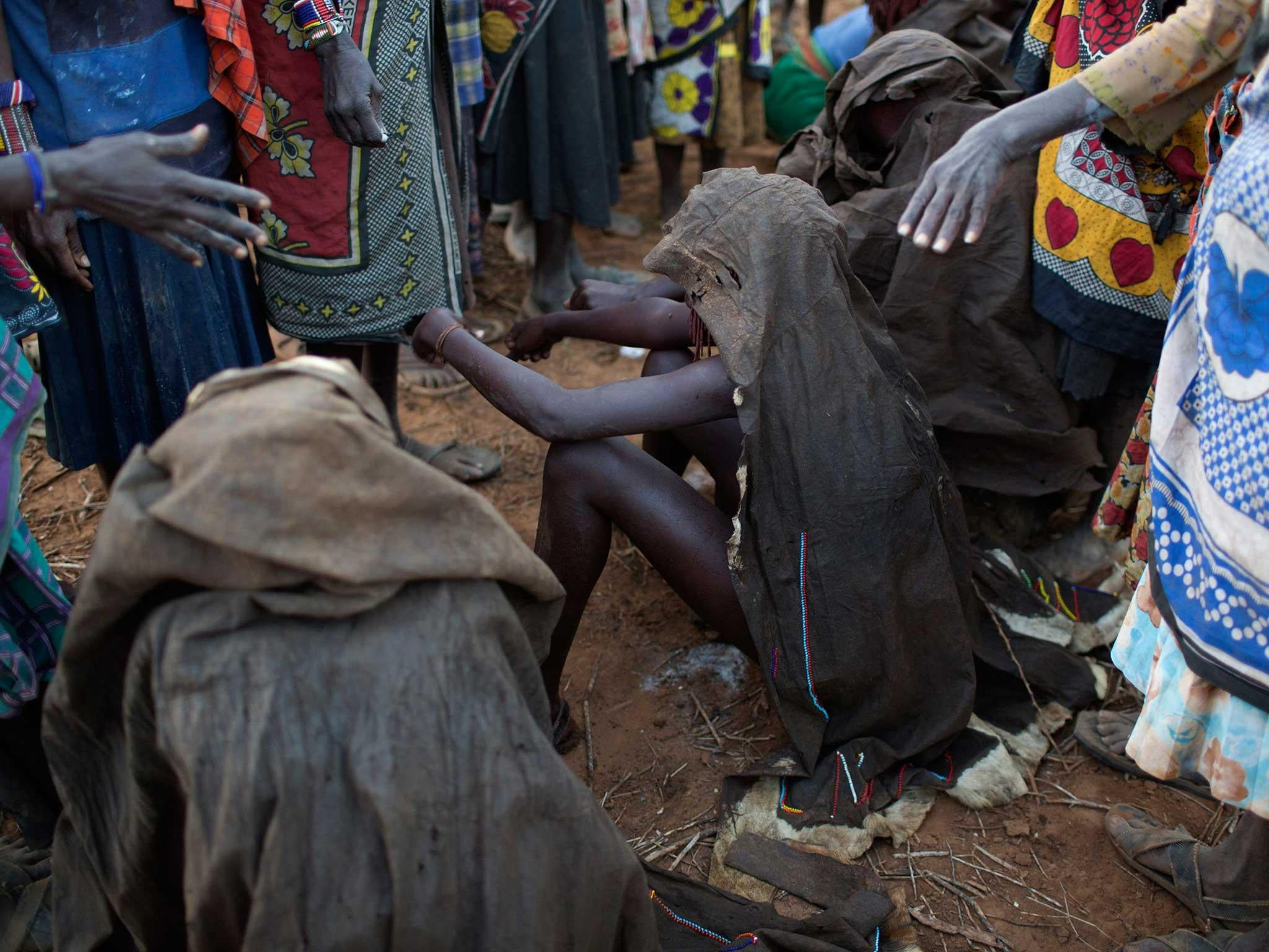 Man and woman charged over female genital mutilation of