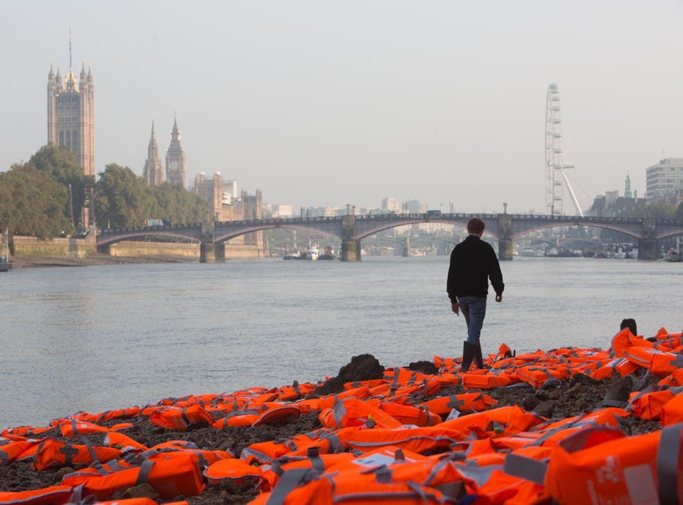 Hundreds of life jackets lie on bank of Thames. Picture: