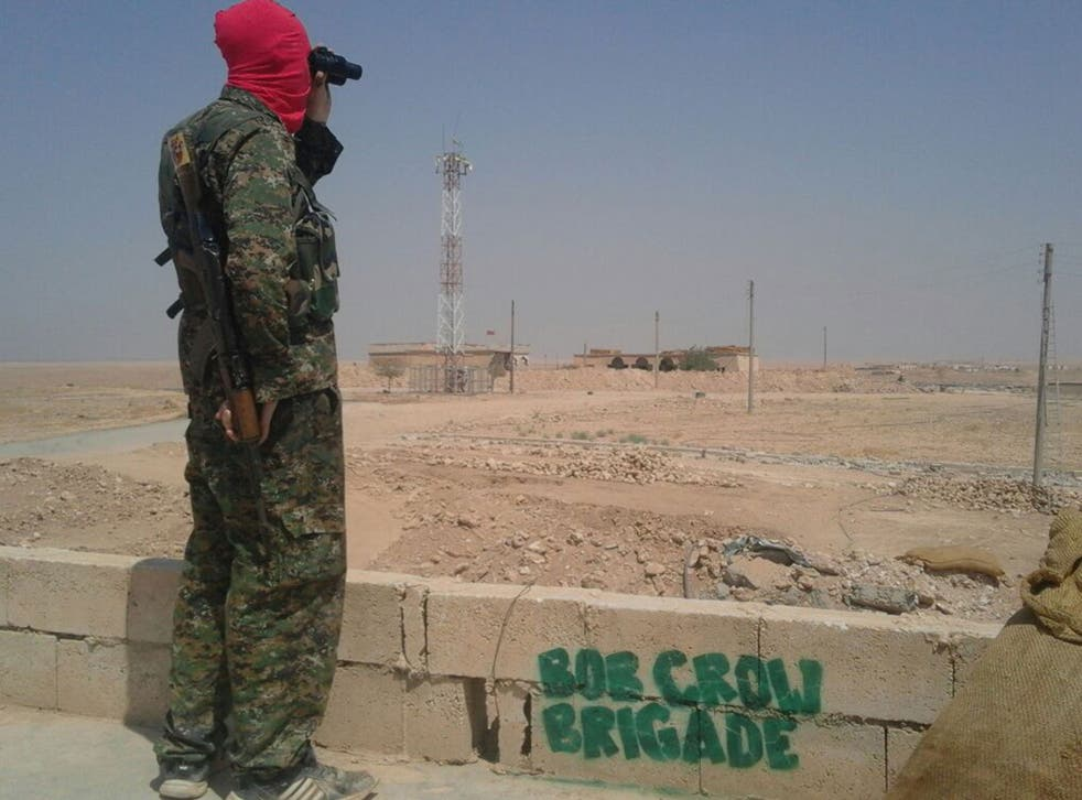 A member of the Bob Crow Brigade keeping watch in northern Syria
