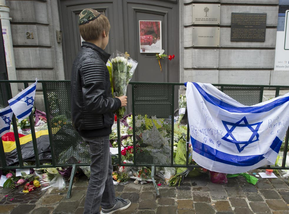 Flowers are laid outside Brussels' Jewish Museum after a terrorist attack left four dead in 2014