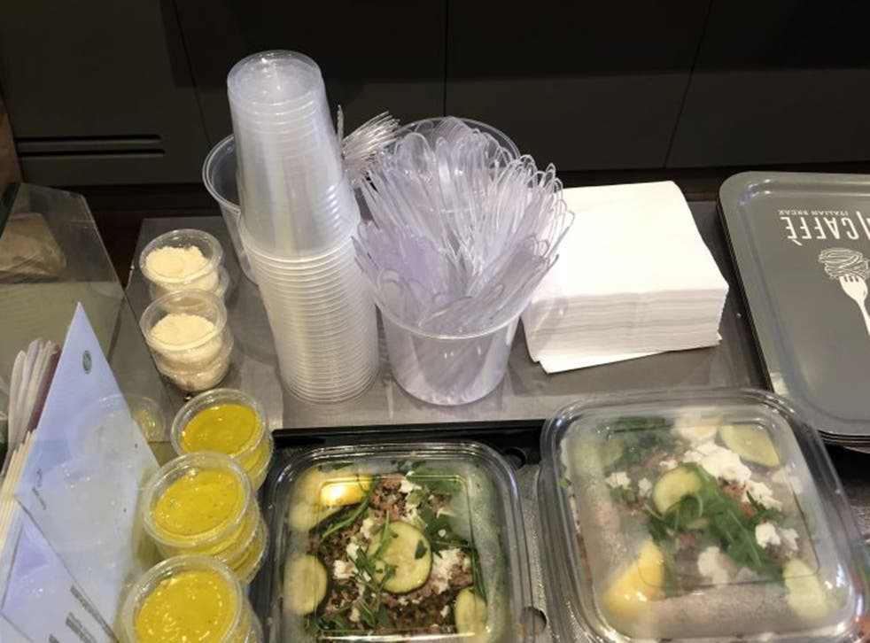 Plastic glasses, knives, forks and food boxes are pictured in a takeaway restaurant in Paris