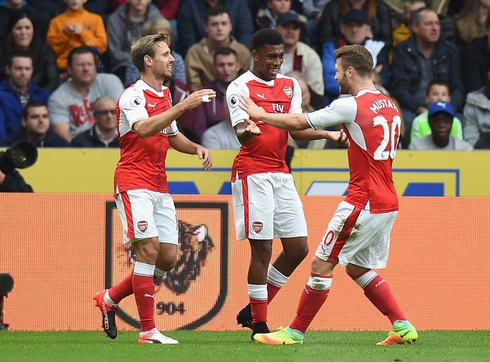 Alex Iwobi celebrates putting Arsenal ahead at Hull - although replays revealed Alexis Sanchez got the last touch